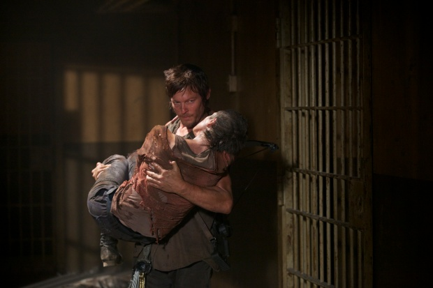 "Norman Reedus as ""Daryl Dixon"" and Melissa Suzanne McBride as ""Carol"" (Image Credit: Blake Tyers/AMC)"