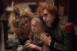 Helena Bonham Carter, Isabelle Allen, and Sacha Baron Cohen in LES MISERABLES (Image Credit: Universal Pictures)
