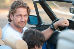 Gerard Butler and Noah Lomax in PLAYING FOR KEEPS (Image Credit: Dale Robinette)