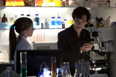 Louise Brealey and Benedict Cumberbatch in SHERLOCK (Image Credit: Hartswood Films/BBC)