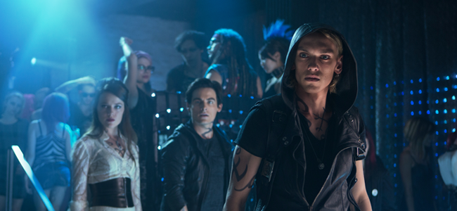 Jemina West as Isabelle Lightwood, Kevin Zegers as Alec Lightwood, and Jamie Campbell Bower as Jace Wayland in MORTAL INSTRUMENTS: CITY OF BONES
