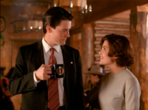 Sherilyn Fenn as Audrey Horne and Kyle MacLachlan as Agent Dale Cooper in TWIN PEAKS