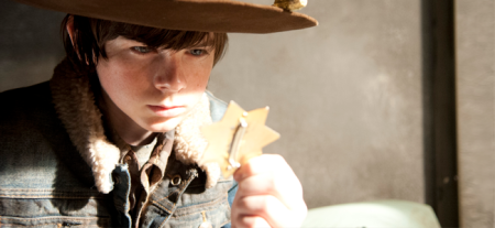 Chandler Riggs as Carl Grimes in THE WALKING DEAD (Image Credit: Gene Page/AMC)