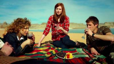 Alex Kingston as Melody Pond, Karen Gillan as Amy Pond, and Arthur Darvill as Rory Williams in DOCTOR WHO (Image Credit: BBC)
