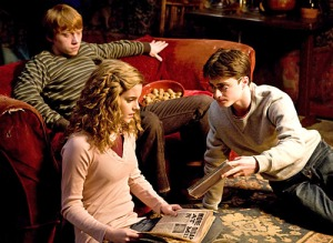 Rupert Grint as Ron Weasley, Emma Watson as Hermione Granger, and Daniel Radcliffe as Harry Potter in HARRY POTTER AND THE GOBLET OF FIRE (Image Credit: Warner Bros.)