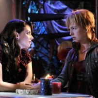 Mia Kirshner as Kenya and Brittany Allen as Tirra in DEFIANCE (Image Credit: Ben Mark Holzberg/Syfy)