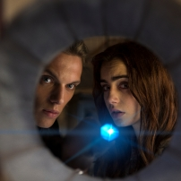 Jamie Campbell Bower as Jace Wayland and Lily Collins as Clary Fray in THE MORTAL INSTRUMENTS: CITY OF BONES (Image Credit: 2013 Constantin Film International GmbH and Unique Features (TMI) Inc.)