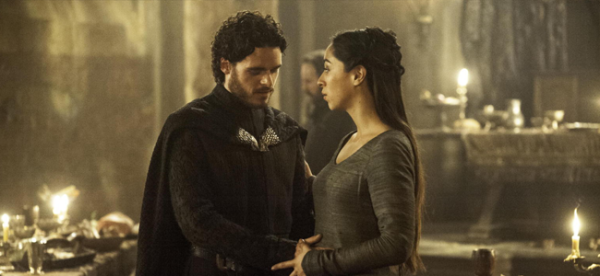 Richard Madden as Robb Stark and Oona Chaplin as Talisa Maegyr in GAME OF THRONES (Image Credit: HBO)