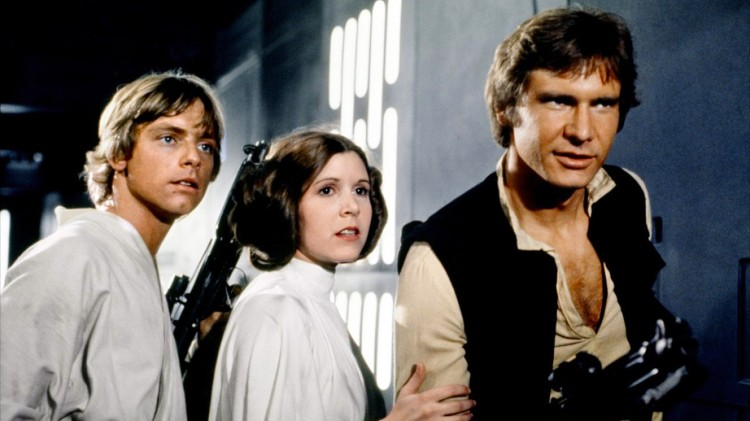 Mark Hamill as Luke Skywalker, Carrie Fisher as Princess Leia Organa, and Harrison Ford as Han Solo in STAR WARS (Image Credit: Lucasfilm)
