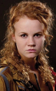 Mackenzie Lintz as The District 8 Tribute Girl in THE HUNGER GAMES (Image Credit: Lionsgate)