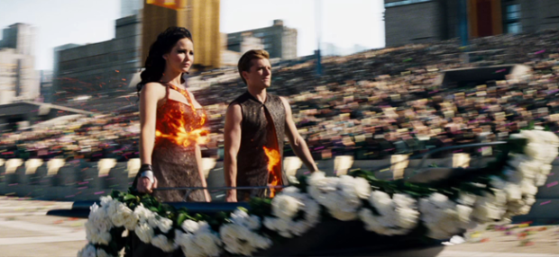 Jennifer Lawrence as Katniss Everdeen and Josh Hutcherson as Peeta Mellark in THE HUNGER GAMES: CATCHING FIRE (Image Credit: Lionsgate)