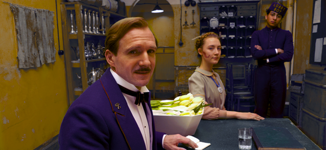 Ralph Fiennes as M. Gustave, Saoirse Ronan as Agatha and Tony Revolori as Zero in THE GRAND BUDAPEST HOTEL (Image Credit: FOX Searchlight)