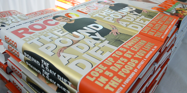 Book Display at Chef Rocco DiSpirito's Signing Event (Image Credit: Saily Regueiro/The Daily Quirk)