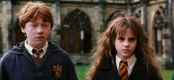 Rupert Grint as Ron Weasley and Emma Watson as Hermione Granger in HARRY POTTER AND THE CHAMBER OF SECRETS (Image Credit: Warner Bros.)