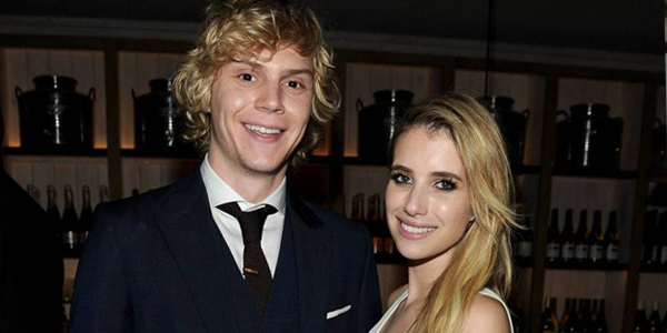 Evan Peters and Emma Roberts attend the AMERICAN HORROR STORY: COVEN Premiere Event (Image Credit: Frank Micelotta/Invision for FX/AP Images)