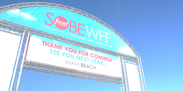 Grand Tasting Village Sign at SOBEWFF (Image Credit: Victor Mascitelli/The Daily Quirk)