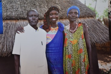 Nykhor Paul with her parents in Ethiopia (Image Credit: Original Photography by Nykhor Paul | Lauren Gambino / The Daily Quirk)